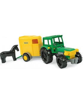 Traktor s přívěsem a koníkem